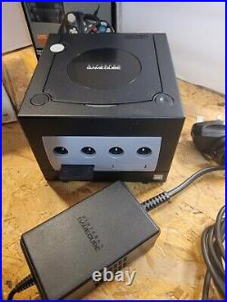Boxed Nintendo Gamecube with manual, controller memory card and cables in