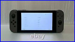 Gray Nintendo Switch Bundle 32GB, 64GB SD Card, 2 Games, 2 Pro Controllers, Case