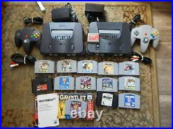 LOT OF 2 NINTENDO 64 CONSOLES with 2 CONTROLLERS, 13 GAMES, 1 MEMORY CARD