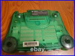 Nintendo 64 Jungle Green Console withIce Blue controller/card, hookups, power cable
