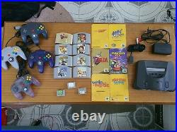 Nintendo 64 console + 8 games (6 booklets), 4 controllers, 3 memory cards