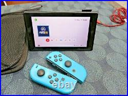 Nintendo Switch Console with 64 GB Memory Card and 2 blue controller's