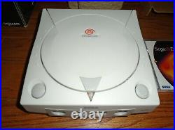 Sega Dreamcast system/console with box, 4 controllers, 7 games and memory card